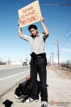 Shah Rukh Khan with a sign in My Name Is Khan Movie