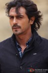 Arjun Rampal poses for the shutterbugs in We Are Family Movie